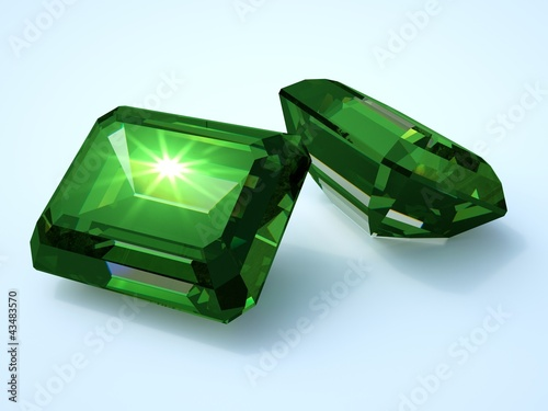 two emerald precious stone with reflection