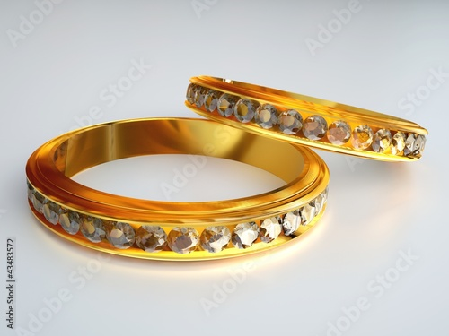 two gold diamond rings