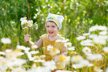 girl in summer camomile plant