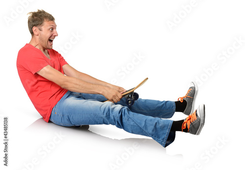Funny humorous man with skateboard on white