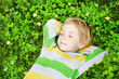 Little child sleeping in outdoors on grass