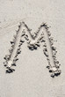 Sand beach alphabet: letter M