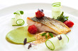 Grilled seabass with cherry tomatoes and avocado.