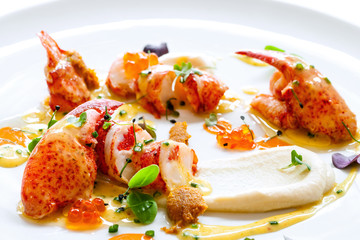 Lobster with caviar and seafood dressings.