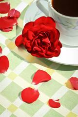 A mug of coffee and rose