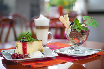 Ice cream, cake and coffee at restaurant table