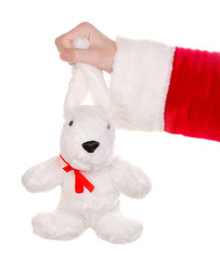 Santa Claus hand holding toy rabbit isolated on white