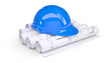 Blue construction helmet on the rolls of architectural drawings