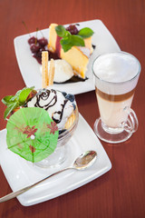 Ice cream, cake and coffee at table