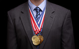 Fototapety Succesful businessman with gold medals