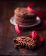 Chocolate chip cookie with red christmas ribbon