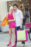 Young attractive couple in shop