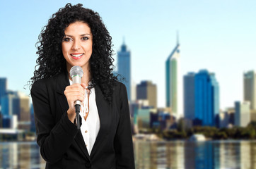 Young businesswoman public speaking