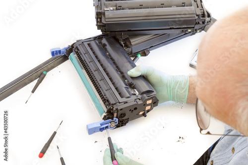adult man working toner cartridge