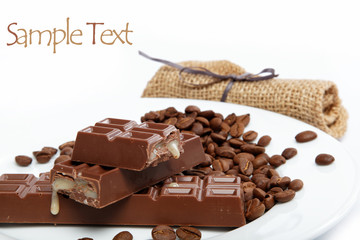Chocolate and coffee beans on a white background.