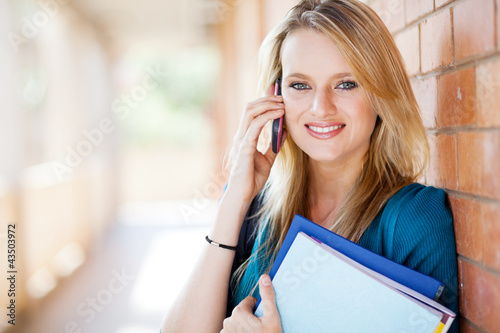 attractive female college student talking on cell phone