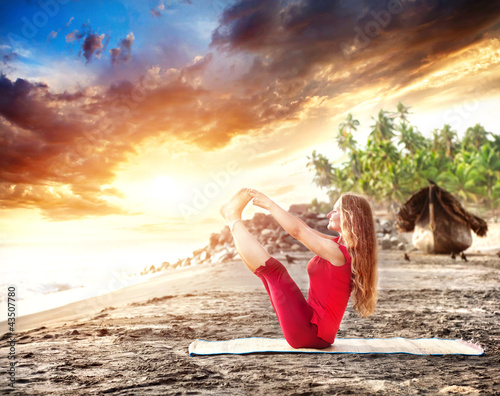 Yoga at sunset beach