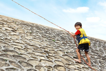 kid climbing using rope