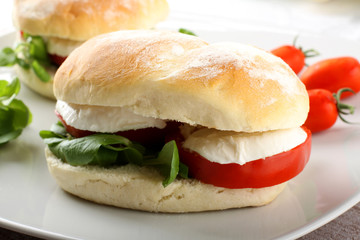 Sandwiches with mozzarella, tomato and lettuce