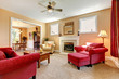 Beautiful peach and red liiving room interior with firepalce.