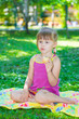 little girl sits in the park
