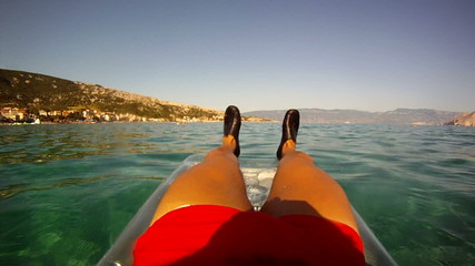 relaxing on beach mattress -created by gopro camera