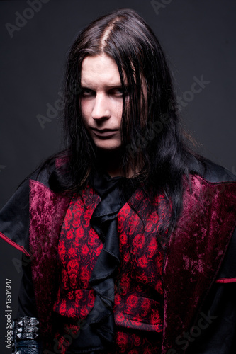 studio portrait of a man dressed as a vampire