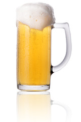 Frosty glass of light beer with foam isolated