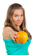 Young woman holding a orange