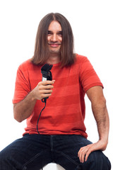 Happy long haired man with hair trimmer