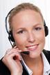 freundliche Frau mit Headset im Kundendienst