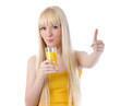 Pretty woman sipping orange juice and giving thumbs up