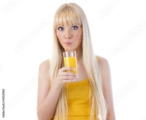 Surprised woman sipping orange juice