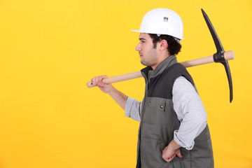 Profile of man with pick-axe