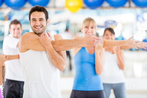 People warming up at the gym