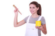 Woman holding paint pot and brush