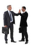 Two businessmen giving each other high-five