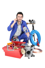 Plumber with a toolbox and cellphone