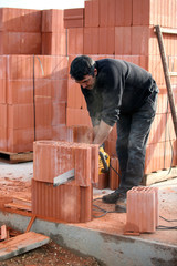Builder cutting blocks to size
