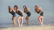 Group of four beautiful women dancing in the water