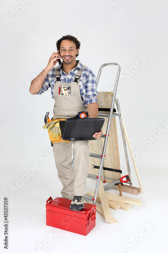Labourer stood with telephone