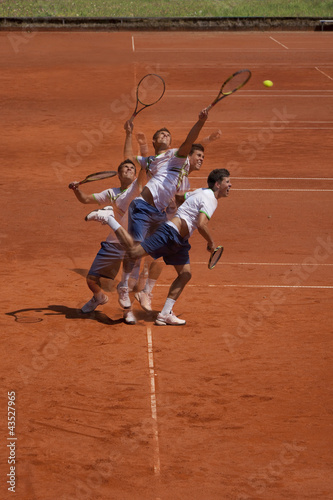 tennis player at the service (multiple exposure)