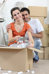 Couple unpacking fragile box