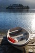 Постер, плакат: Boat on the dock Orta St Giulio lake and island Italy
