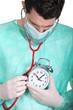doctor auscultating  alarm clock