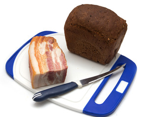 bacon with rye bread on a white background