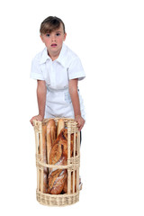 A kid dressed as a baker.