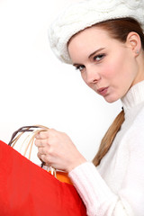 Woman wearing bonnet carrying shopping bags