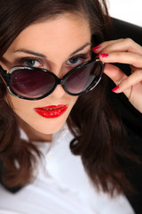 brunette with captivating gaze and red lipstick