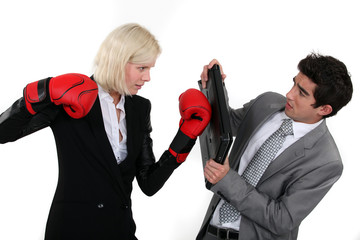 Businesspeople boxing.